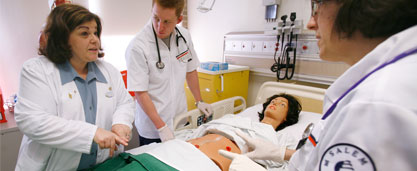 image of nursing student in clinical setting with patient